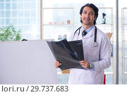 Купить «Young handsome male radiologist in front of whiteboard», фото № 29737683, снято 21 ноября 2018 г. (c) Elnur / Фотобанк Лори