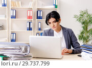 Middle aged businesslady unhappy with excessive work. Стоковое фото, фотограф Elnur / Фотобанк Лори