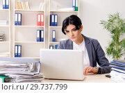 Купить «Middle aged businesslady unhappy with excessive work», фото № 29737799, снято 15 ноября 2018 г. (c) Elnur / Фотобанк Лори