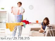 Купить «Husband helping leg injured wife in housework», фото № 29738315, снято 4 октября 2018 г. (c) Elnur / Фотобанк Лори