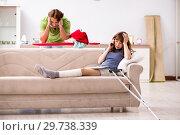 Купить «Husband helping leg injured wife in housework», фото № 29738339, снято 4 октября 2018 г. (c) Elnur / Фотобанк Лори