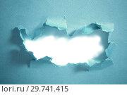 Купить «Hole in blue paper, abstract background», фото № 29741415, снято 1 марта 2018 г. (c) Майя Крученкова / Фотобанк Лори