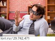 Купить «Young employee with virtual glasses during break in the office», фото № 29742471, снято 10 сентября 2018 г. (c) Elnur / Фотобанк Лори