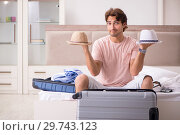 Купить «Man with suitcase in bedroom waiting for trip», фото № 29743123, снято 17 сентября 2018 г. (c) Elnur / Фотобанк Лори