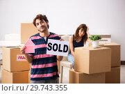 Купить «Young family selling their house», фото № 29743355, снято 21 сентября 2018 г. (c) Elnur / Фотобанк Лори