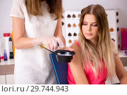 Купить «Customer choosing colour for her hair», фото № 29744943, снято 16 августа 2018 г. (c) Elnur / Фотобанк Лори