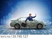 Купить «Businessman driving car covered with us dollars», фото № 29745127, снято 20 января 2019 г. (c) Elnur / Фотобанк Лори