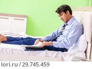 Купить «Businessman working overtime in hotel room», фото № 29745459, снято 22 июня 2018 г. (c) Elnur / Фотобанк Лори