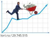 Купить «Businessman pushing wheelbarrow full of dollar money», фото № 29745515, снято 23 апреля 2019 г. (c) Elnur / Фотобанк Лори