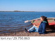 Купить «Brunette girl in a jacket in the fall near a boat on the bank of the Amur River, below the village of Sikachi-Alyan», фото № 29750863, снято 30 сентября 2018 г. (c) Катерина Белякина / Фотобанк Лори