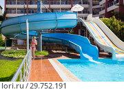 Купить «Girl at the pool with slides at resort», фото № 29752191, снято 23 апреля 2019 г. (c) Светлана Кузнецова / Фотобанк Лори