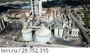 Купить «Aerial view of cement production plant», видеоролик № 29752315, снято 26 августа 2018 г. (c) Яков Филимонов / Фотобанк Лори