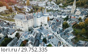 Купить «Aerial view of medieval castle of Chateau de Langeais located in commune of same name in Indre-et-Loire department, France», видеоролик № 29752335, снято 25 октября 2018 г. (c) Яков Филимонов / Фотобанк Лори