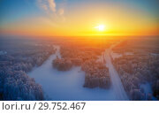 Купить «Sun over siberian forest under the snow at morning time. Siberian rural winter sunrise landscape with birch trees covered with hoarfrost.», фото № 29752467, снято 4 января 2019 г. (c) Serg Zastavkin / Фотобанк Лори