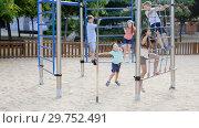 Купить «Glad children playing at the playground», видеоролик № 29752491, снято 23 июля 2018 г. (c) Яков Филимонов / Фотобанк Лори