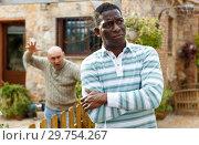 Купить «Man ignoring neighbor after quarrel», фото № 29754267, снято 15 декабря 2018 г. (c) Яков Филимонов / Фотобанк Лори