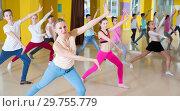 Купить «Tweens exercising with coach in choreography class», фото № 29755779, снято 3 марта 2018 г. (c) Яков Филимонов / Фотобанк Лори