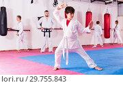 Купить «Boy in kimono exercising new techniques», фото № 29755843, снято 26 мая 2020 г. (c) Яков Филимонов / Фотобанк Лори