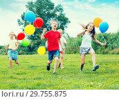 Купить «Four friendly glad kids running on green lawn», фото № 29755875, снято 22 января 2019 г. (c) Яков Филимонов / Фотобанк Лори