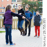 Купить «Children playing rubber band jumping game and laughing», фото № 29755951, снято 6 декабря 2019 г. (c) Яков Филимонов / Фотобанк Лори