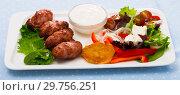 Купить «Photography of plate with kebets and vegetables», фото № 29756251, снято 9 апреля 2020 г. (c) Яков Филимонов / Фотобанк Лори