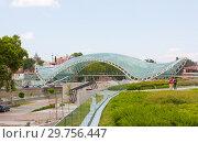 Купить «The Bridge of Peace . The bridge stretches over the Kura river and connects the areas of old city.», фото № 29756447, снято 9 августа 2013 г. (c) Олег Хархан / Фотобанк Лори