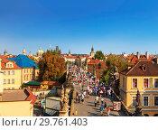 Купить «Top view of center of Prague with its red roofs and tourists on the Charles bridge, Prague, Czech Republic», фото № 29761403, снято 5 сентября 2014 г. (c) Наталья Волкова / Фотобанк Лори
