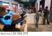 Купить «Paintball players aiming in opponents», фото № 29768375, снято 10 июля 2017 г. (c) Яков Филимонов / Фотобанк Лори