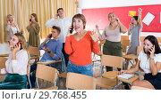 Купить «Happy students talking on phones», фото № 29768455, снято 22 сентября 2019 г. (c) Яков Филимонов / Фотобанк Лори