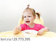 Crying little girl dont want to eat soup. Стоковое фото, фотограф ivolodina / Фотобанк Лори