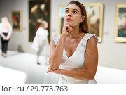 Купить «Woman observing museum exposition», фото № 29773763, снято 28 июля 2018 г. (c) Яков Филимонов / Фотобанк Лори