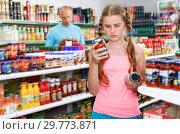 Купить «Tween girl choosing and buying food products at grocery shop», фото № 29773871, снято 4 июля 2018 г. (c) Яков Филимонов / Фотобанк Лори