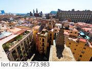 Купить «Roofs of narrow street of european city. Barcelona», фото № 29773983, снято 1 сентября 2015 г. (c) Яков Филимонов / Фотобанк Лори