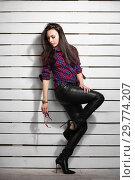 Купить «Sexy young brunette posing standing.», фото № 29774207, снято 26 апреля 2016 г. (c) Сергей Сухоруков / Фотобанк Лори