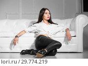 Купить «Thoughtful woman posing in studio.», фото № 29774219, снято 26 апреля 2016 г. (c) Сергей Сухоруков / Фотобанк Лори