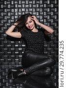Купить «Young smile lady in black clothes.», фото № 29774235, снято 26 апреля 2016 г. (c) Сергей Сухоруков / Фотобанк Лори
