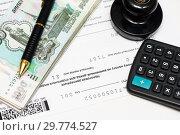 Купить «Оплата налогов. Калькулятор, печать организации, тысячные купюры, ручка и налоговая декларация на вменённый доход», эксклюзивное фото № 29774527, снято 16 января 2019 г. (c) Игорь Низов / Фотобанк Лори