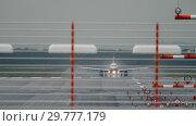 Купить «Airplane departure at rain», видеоролик № 29777179, снято 26 августа 2018 г. (c) Игорь Жоров / Фотобанк Лори