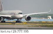 Купить «Airbus 350 taxiing before departure», видеоролик № 29777195, снято 19 июля 2017 г. (c) Игорь Жоров / Фотобанк Лори