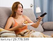 Купить «Smiling female eating sweet cake», фото № 29778599, снято 14 июля 2020 г. (c) Яков Филимонов / Фотобанк Лори