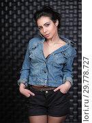 Купить «Charming brunette posing in the studio.», фото № 29778727, снято 7 апреля 2016 г. (c) Сергей Сухоруков / Фотобанк Лори