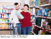 Купить «two smiling adult people in good spirits selecting detergents in the store», фото № 29779027, снято 14 марта 2017 г. (c) Яков Филимонов / Фотобанк Лори