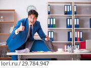 Купить «Employee stealing important information in industrial espionage», фото № 29784947, снято 10 августа 2018 г. (c) Elnur / Фотобанк Лори