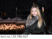 Купить «Charming young blonde in black clothes.», фото № 29786927, снято 16 января 2016 г. (c) Сергей Сухоруков / Фотобанк Лори