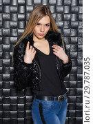 Купить «Portrait of a young woman posing in the studio», фото № 29787035, снято 22 февраля 2016 г. (c) Сергей Сухоруков / Фотобанк Лори