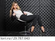 Купить «Sexy woman posing on a chair», фото № 29787043, снято 22 февраля 2016 г. (c) Сергей Сухоруков / Фотобанк Лори