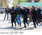 Купить «Protester is arrested by police at the opposition rally», фото № 29787159, снято 5 мая 2018 г. (c) FotograFF / Фотобанк Лори