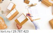 Купить «woman with laptop and clipboard at post office», видеоролик № 29787423, снято 19 января 2019 г. (c) Syda Productions / Фотобанк Лори