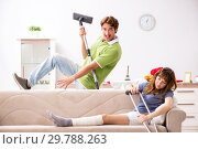 Купить «Husband helping leg injured wife in housework», фото № 29788263, снято 4 октября 2018 г. (c) Elnur / Фотобанк Лори