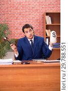 Купить «Young handsome lawyer working in his office», фото № 29788551, снято 10 сентября 2018 г. (c) Elnur / Фотобанк Лори